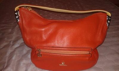 Подать объявление.  Кожаную сумку Villena Fabiano в Омске.